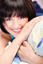 Girl on pillow cute smiling Stock Photos