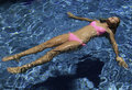 Girl in pink bikini floating Stock Image