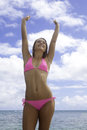 Girl in pink bikini by the ocean Royalty Free Stock Photo