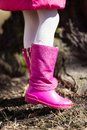 Girl in pink boots on a spring day.