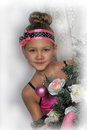 Girl in pink in christmas with flowers Stock Photo