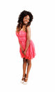 Girl in pink dress a lovely jamaican young woman a with her curly black hair standing isolated on white background Stock Images
