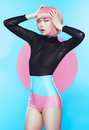 Girl with pink haircut in bodysuit