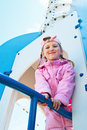 Girl in pink on a playground Stock Image