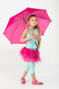 A girl in a pink skirt with umbrella Stock Photos