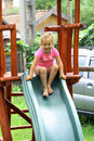 Girl in pink on slide Stock Image