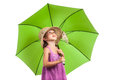 Girl in pink with sun umbrella looking up Stock Image
