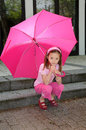 Girl with pink umbrella Royalty Free Stock Image
