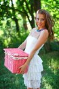 Girl with pink vintage basket Royalty Free Stock Images