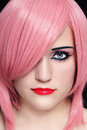 Girl in pink wig close up portrait of young beautiful woman Royalty Free Stock Photography