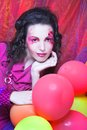Girl in pink young woman dress with artistic visage and with baloons Royalty Free Stock Photo