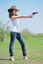 Girl and pistol Royalty Free Stock Photo
