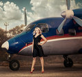 Girl at the plane stands Stock Photos