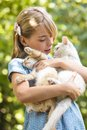 Girl play with kitten outdoor in the park Royalty Free Stock Image