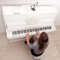 Girl play piano Royalty Free Stock Images