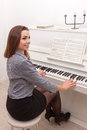 Girl play piano Royalty Free Stock Photo