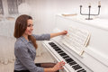 Girl play piano Stock Images