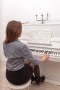 Girl play piano Royalty Free Stock Image