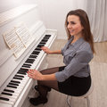 Girl play piano Royalty Free Stock Photos