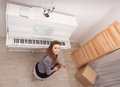 Girl play piano young attractive Stock Photography