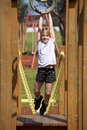 Girl on playground equipment Royalty Free Stock Photo