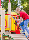 Girl on playground smile blond Royalty Free Stock Image