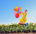 Girl playing with balloons in summer time Stock Photos