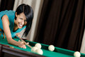 Girl playing billiard spending free time on gambling Royalty Free Stock Photos