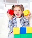 Girl playing with blocks Royalty Free Stock Photos