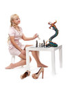 Girl playing chess with a decorative dragon Royalty Free Stock Images