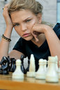 Girl playing chess. Royalty Free Stock Photo
