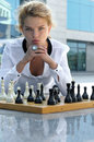 Girl playing chess outdoors. Royalty Free Stock Photo