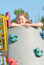 Girl playing on climbing wall Royalty Free Stock Photo