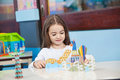 Girl playing with craft in classroom pretty little preschool Stock Photos