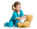 Girl playing doctor and curing plush toy Stock Image