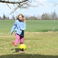 Girl playing football Royalty Free Stock Photo