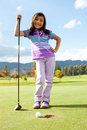 Girl playing golf Royalty Free Stock Image