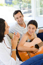 Girl playing guitar with her parents middle aged Royalty Free Stock Images