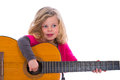 Girl playing guitar little is with the Royalty Free Stock Image
