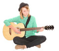 Girl playing guitar teen musician sitting cross legged acoustic Royalty Free Stock Photography