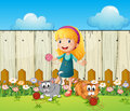 A girl playing with her cats inside the fence illustration of Stock Images