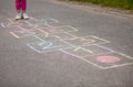 Girl playing hop-scotch outside Royalty Free Stock Photo