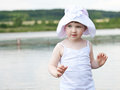 Girl playing in a lake Stock Photography