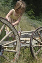 Girl playing on old wagon Royalty Free Stock Photography