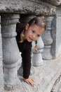 Girl playing peek a boo Royalty Free Stock Photo