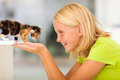 Girl playing pet loving teen with kitten at home Stock Images