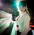 Girl playing on piano Stock Images