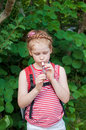 Girl playing a pipe in nature Stock Photography