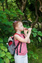 Girl playing a pipe in nature Stock Image