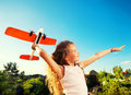 Girl playing with plane child happy play outdoors Stock Photos